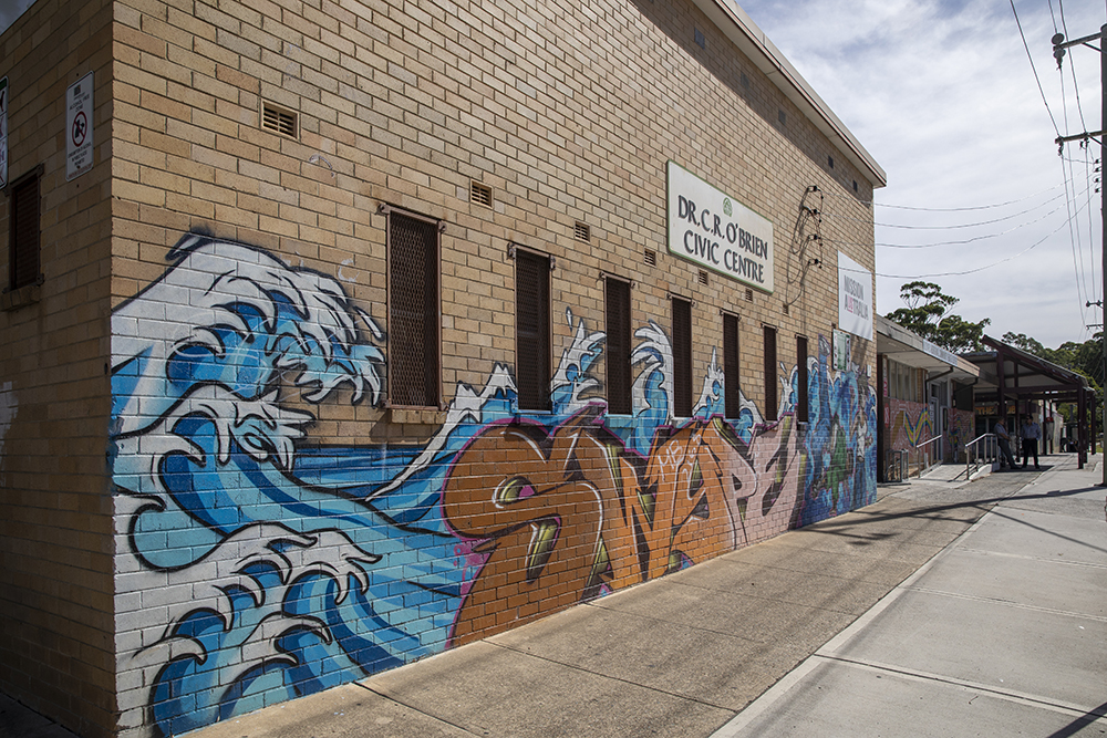 Miller Community Centre and The Hub with street art on wall