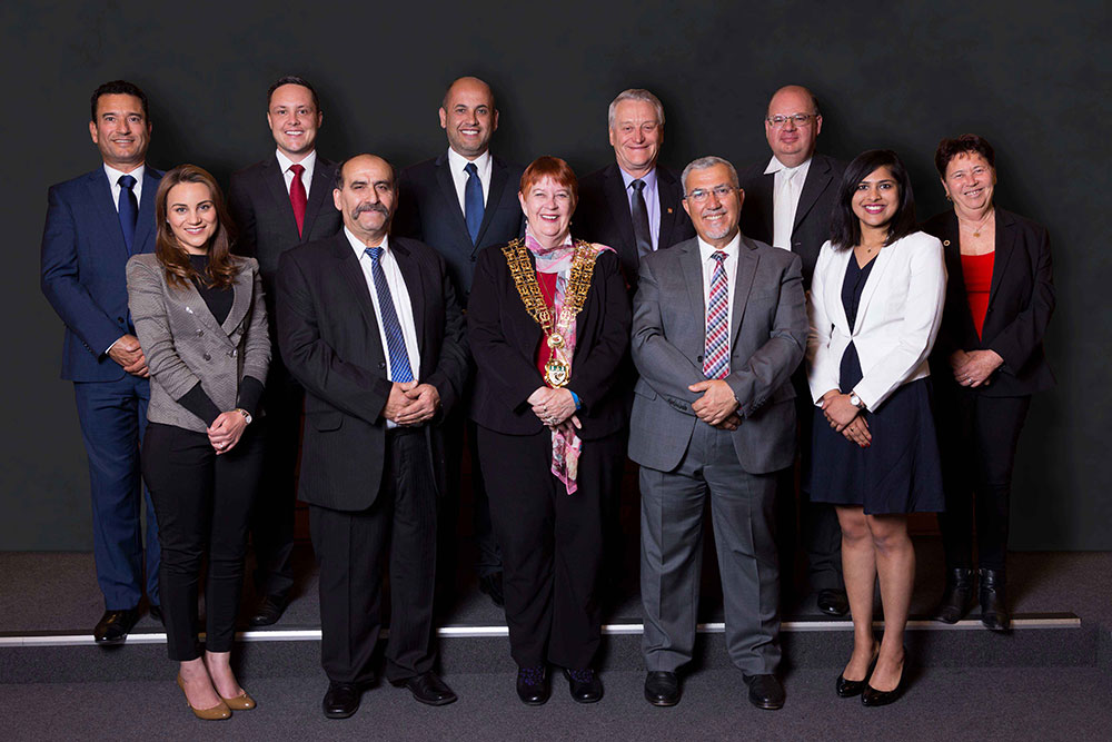 Liverpool Councillors standing together in a studio setting